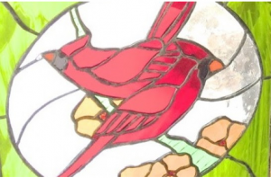 Image of a stained glass cardinal created by Art