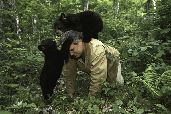 Dr. Ben Kilham with bear cubs
